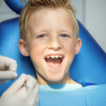 Smiling child after dental sealant placement