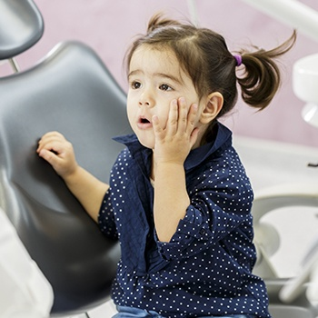 Little girl with toothache in need of pulp therapy