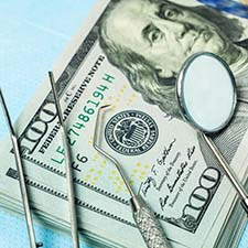Woman brushing teeth to prevent dental emergencies