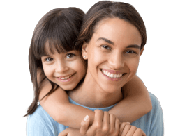 Mother and daughter sharing healthy smiles thanks to preventive dentistry