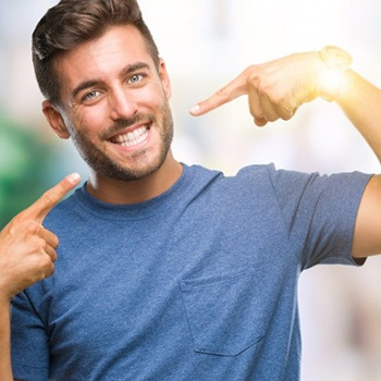 man pointing to his smile
