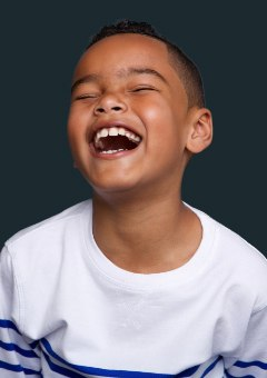 Young boy laughing after children's dentistry