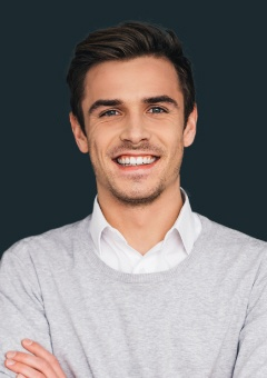 Man with healthy smile after periodontal therapy