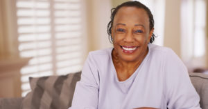 Older woman with dental implants smiles